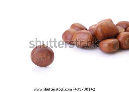 Roasted chestnuts on white floor.