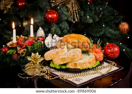 Roasted chicken and candles on a christmas new year table - stock photo