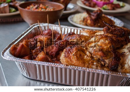 Roasted Chicken and greaves in a steel plate container
