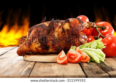 roasted chicken and table  - stock photo