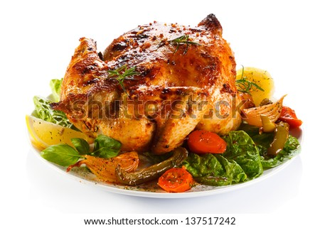 Roasted chicken and vegetables on white background - stock photo