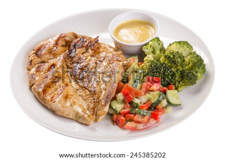 Roasted chicken breast with broccoli isolated on white background. Clipping path