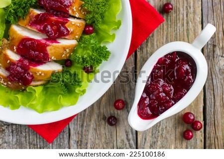 roasted chicken breast with cranberry sauce for christmas dinner, top view - stock photo