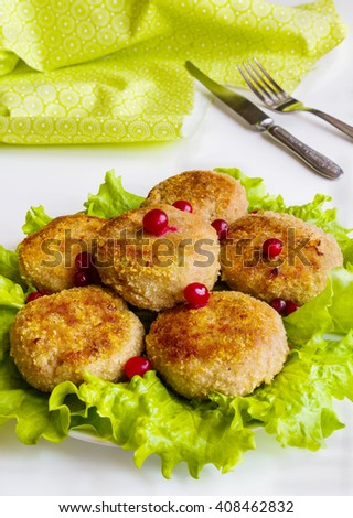 Roasted chicken cutlets on green lettuce on white table. - stock photo