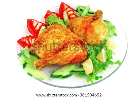 roasted chicken drumstick with vegetables over white - stock photo