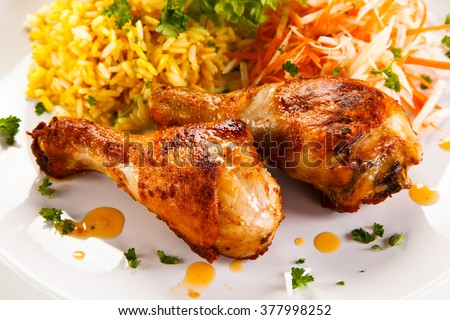 Roasted chicken drumsticks white rice and vegetables  - stock photo