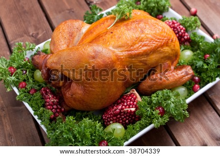 roasted chicken garnished with parsley and fruits - stock photo