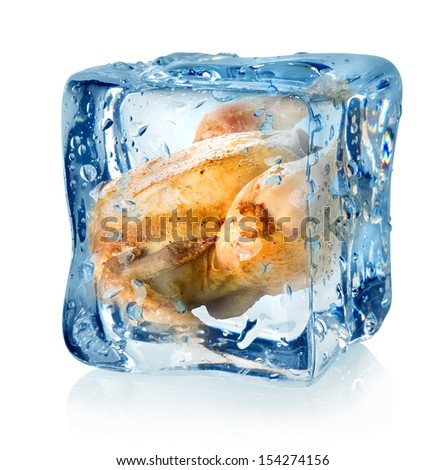Roasted chicken in ice cube isolated on a white background
