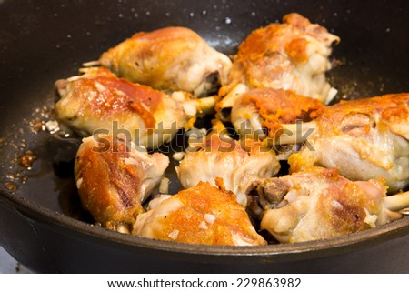 Roasted chicken in pan. Selective focus - stock photo