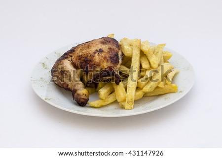 "Roasted chicken leg with fries potato called ""Pollo a la Brasa"" in South America. - stock photo"