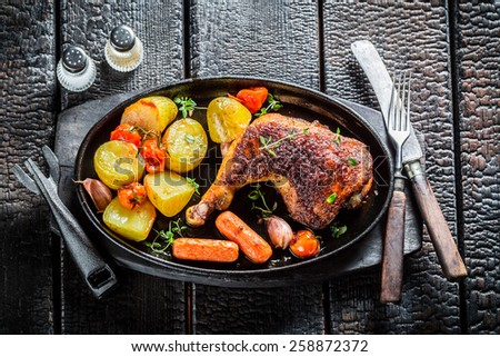 Roasted chicken leg with herbs and spices - stock photo