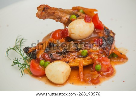 roasted chicken leg with vegetables, herbs and eggs - stock photo