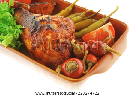 roasted chicken legs and peppers with lettuce - stock photo