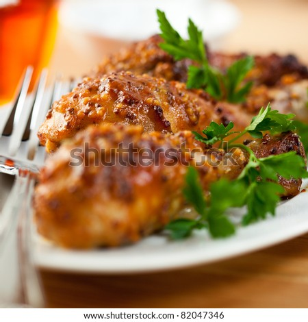 Roasted chicken legs with french mustard