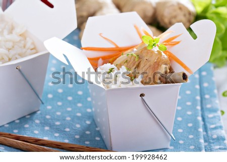 Roasted chicken legs with rice and vegetables - stock photo
