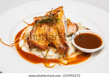 roasted chicken legs with vegetables and herbs - stock photo