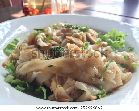 Roasted chicken noodle on white plate - stock photo
