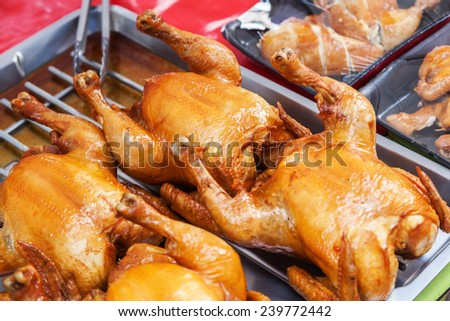 roasted chicken on a grillage - stock photo