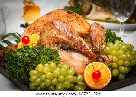 roasted chicken served with fruit and vegetable on wooden tray