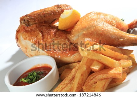 roasted chicken with fries potato and sauce