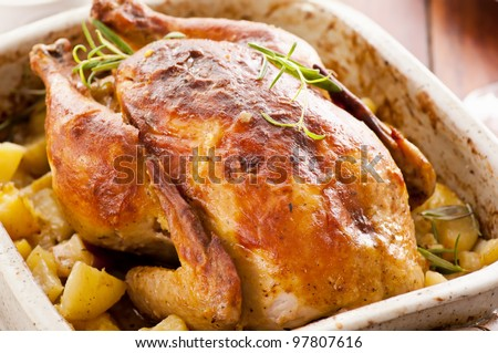 roasted chicken with potato - stock photo