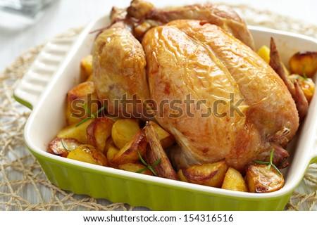 Roasted Chicken with potatos - stock photo