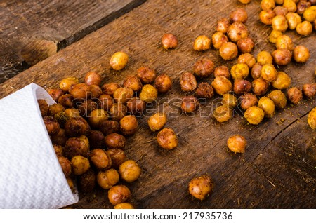 Roasted chickpeas spiced curry, chilli peppers and Hungarian paprica - stock photo