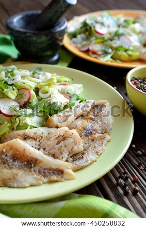 Roasted cod with fresh radish, lettuce and arugula salad