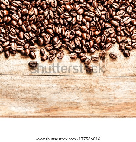 Roasted Coffee Beans background texture on wooden board frame isolated on white background with copy space for text, macro. Fragrant fried coffee beans. - stock photo