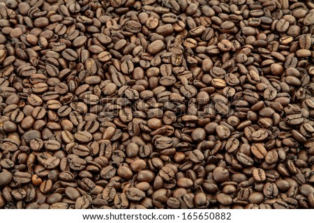 roasted coffee beans, can be used as a background - stock photo