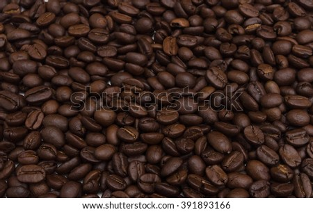 Roasted coffee beans. Close-up of coffee beans for background and texture.
