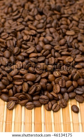 roasted coffee beans close-up on old background