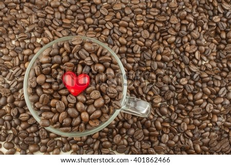 Roasted coffee beans in a glass cup. Love of coffee. We love coffee. Sales of coffee beans. - stock photo