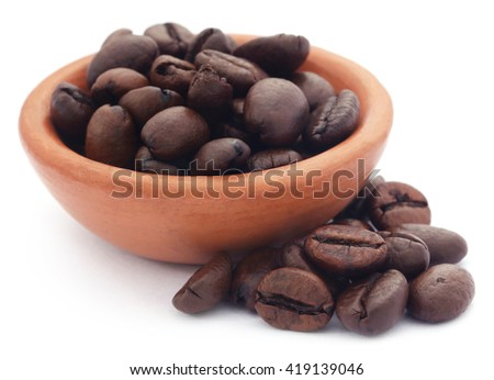 Roasted coffee beans in a pottery over white background - stock photo