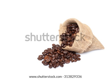 roasted coffee beans in burlap sack, coffee beans in burlap bag isolated on white background. - stock photo