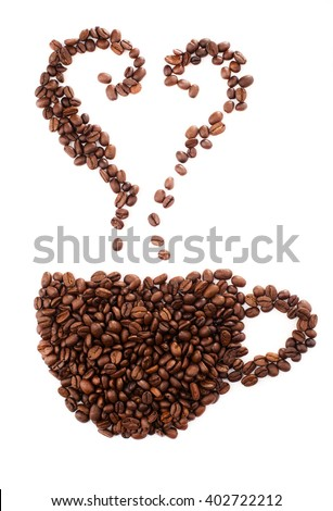 Roasted coffee beans in the shape of the heart. - stock photo