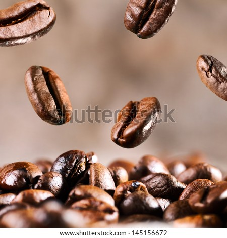 roasted coffee beans is falling down - stock photo