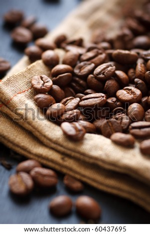 Roasted coffee beans on canvas,shallow focus - stock photo