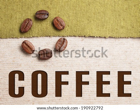 Roasted Coffee Beans on fabric textile with coffee text