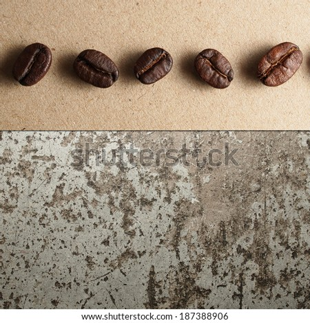 Roasted Coffee Beans on paper and concrete texture - stock photo