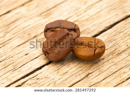 Roasted coffee beans on table - close up shot