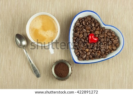 Roasted coffee beans on the kitchen table. Fresh coffee. Preparation of hot coffee. Refreshing drink. Sales of coffee beans. Advertising for coffee shop. We love fresh coffee. - stock photo