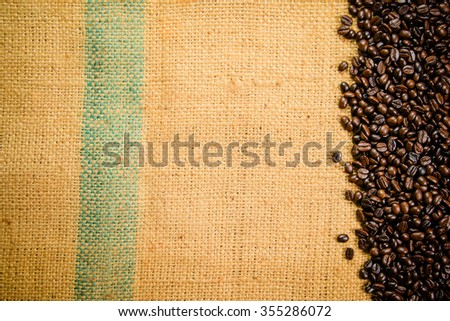 Roasted coffee beans on the linen fabric - stock photo