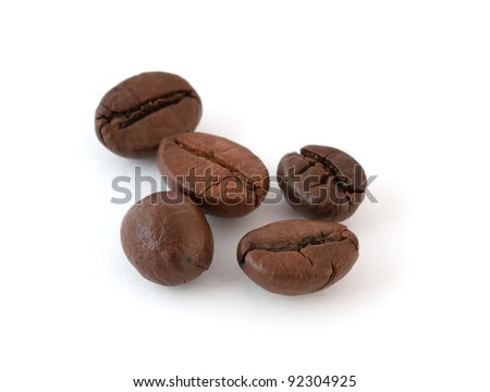 Roasted coffee beans on white background with soft shadow