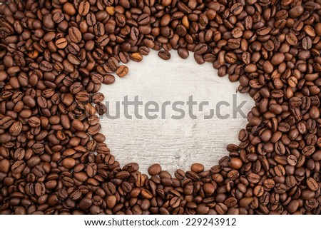 Roasted Coffee Beans on wooden background.