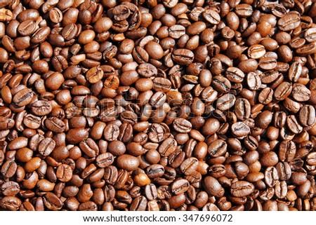 Roasted coffee seeds Plenty of roasted coffee seeds - stock photo