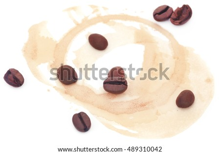 Roasted coffee with cup stain over white background