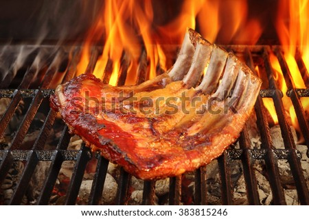 Roasted Country Style Baby Back Or Spare Ribs On The Hot Flaming BBQ Grill, Close-up