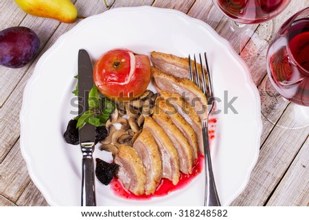Roasted Duck Breasts with Mushroom, Apple and Plums Stuffing in Red Wine Sause - stock photo