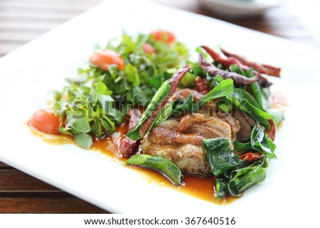 Roasted duck fillet with berry sauce and chilli
